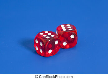Red dices on blue background