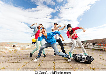 group of teenagers dancing - sport, dancing and urban...