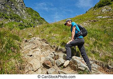 Teenage hiker on mountain trail - Teenage boy with backpack...