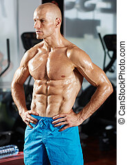 Six packs athlete in a gym - Portrait of a very fit athlete...