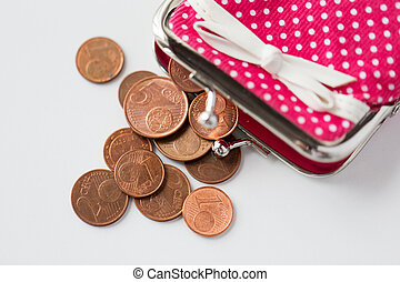close up of euro coins and wallet from top