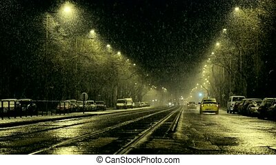 Heavy snowing at night on the streets