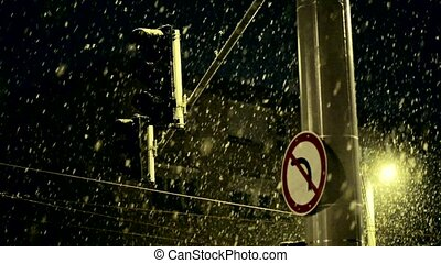 Heavy snowing at night with blinkong lamp