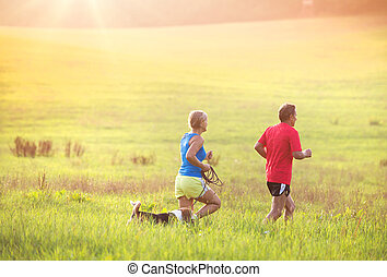 Senior couple running - Active seniors running with their...