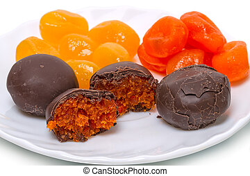 Cumquat and chocolate candies - Dry yellow and orange...