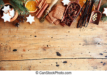 Traditional Christmas spices and cookies arranged as a top...