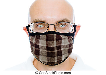 Bald man on a white background in the warm medical mask