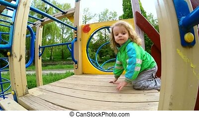 Happy Little Boy Walking On Slide - SLOW MO: Happy cute fair...