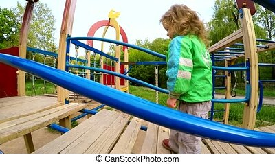 Happy Child Walking On Big Slide