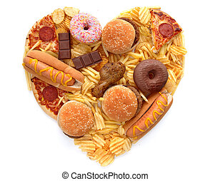 Heart shape junk food - Various types of unhealthy food in...