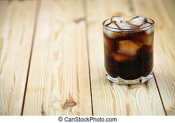 soft drink on a wooden background