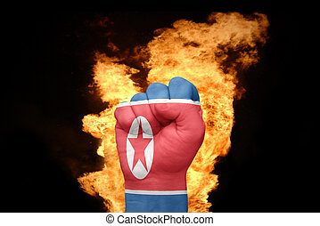 fire fist with the national flag of north korea - fist with...