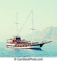 Old classic wooden sailboat in Santorini island, Greece -...