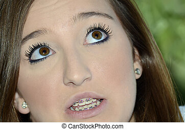 Beautiful Teenage Girl - Teenage girl with braces looking up...