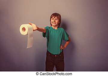 European-looking boy of ten years with toilet paper on a...