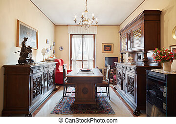 Dining room with antiquities in house in Italy