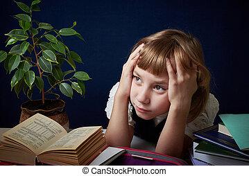 Schoolgirl does homework.