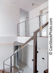 Stairs with steel railing - Vertical view of stairs with...