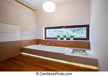 Contemporary bathtub in wooden bathroom