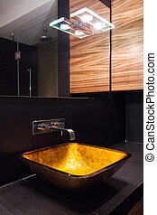 Modern illuminated washbasin in luxury contemporary toilet