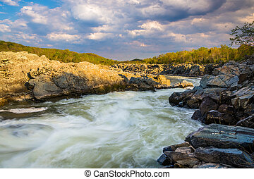 Evening light on rocks and rapids in the Potomac River, at...