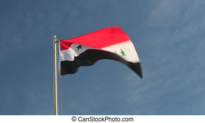 Request flag of Iraq in front of blue sky