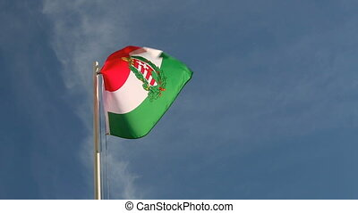Hungary flag in slow motion in front of a blue sky