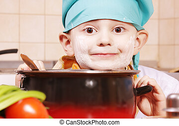 Funny cook and pan - Funny smiling cook face soiled with...