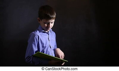 Teenage boy running on the tablet in blue shirt studio background video