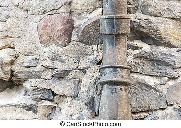 Old metal drainpipe - Old rusty black metal drainpipe on...