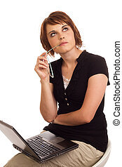 Business woman thinking while working on laptop