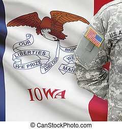 American soldier with US state flag on background - Iowa