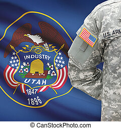 American soldier with US state flag on background - Utah