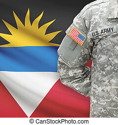 American soldier with flag on background - Antigua and...
