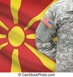 American soldier with flag on background - Republic of Macedonia
