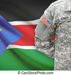 American soldier with flag on background - South Sudan
