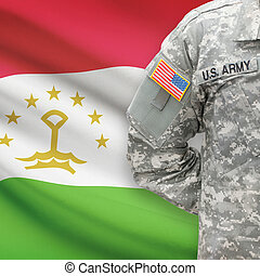 American soldier with flag on background - Tajikistan