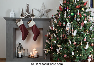 christmas day - cropped shot of a candle fireplace with...