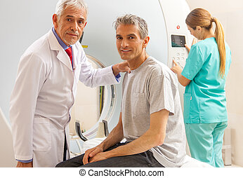 Patient undergoing mri scan with doctor assistance.