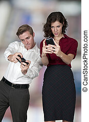 Couple playing video games on their smart phones