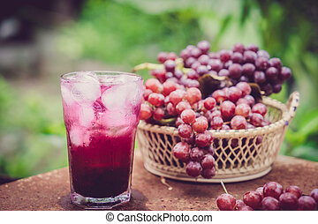 grape juice - Red grape fruits and grape juice on wooden