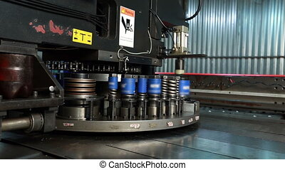 Automatic machine for punching metal in workshop