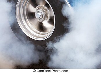 Burnout with spinning wheel - A car doing a burnout so that...