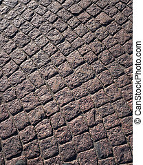 Texture of cobblestone in old town