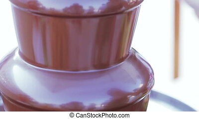 Chocolate fountain - Close up rotating chocolate fountain