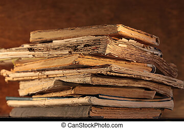 Stack of old books - A stack of old yellowed books closeup