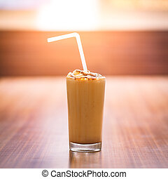 A glass of Chocolate milk shake - A full glass of chilled...