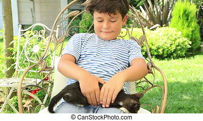 Happy little boy loves his kitty - Little boy hugging his...
