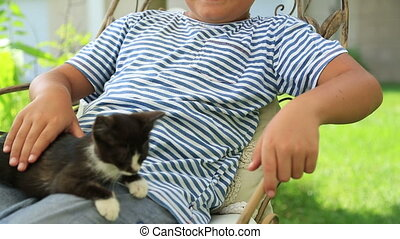 Happy little boy loves his kitty - Little boy hugging his...