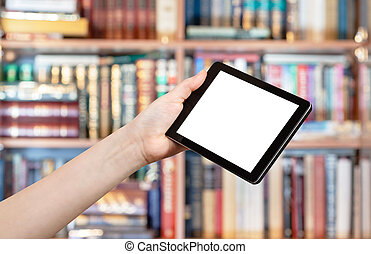 hand holds tablet pc in library - hand holds tablet pc with...